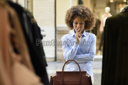 woman with afro hairstyle looking in