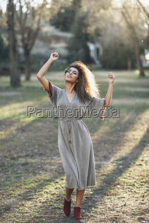 fashionable young woman dancing in a
