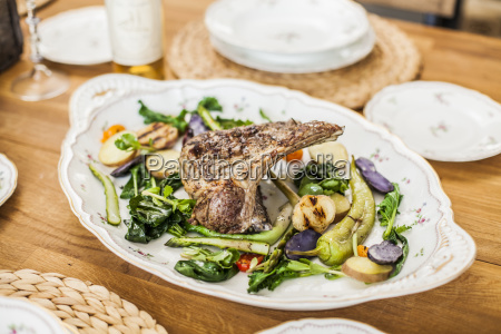 lamb and vegetables on platter