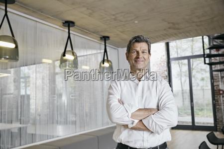 portrait of confident businessman in modern
