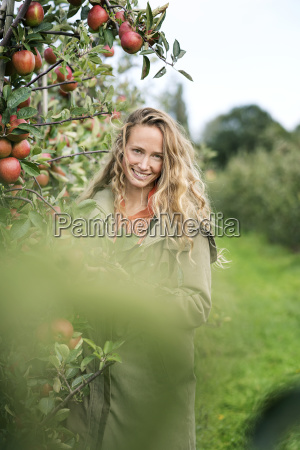 portrait of smiling woman in apple