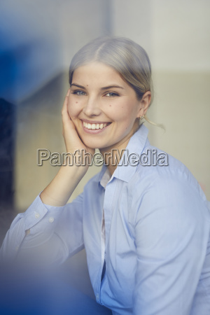 portrait of content businesswoman looking out