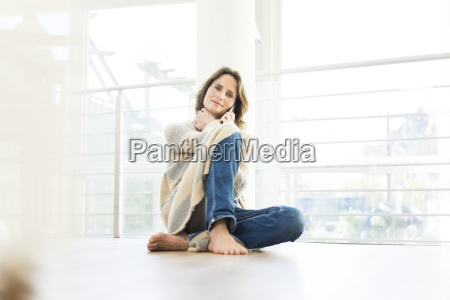 portrait of relaxed woman sitting on