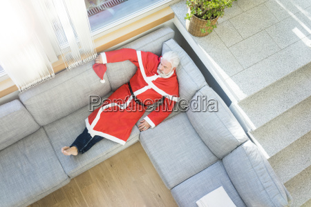 bearded mature man wearing santa costume