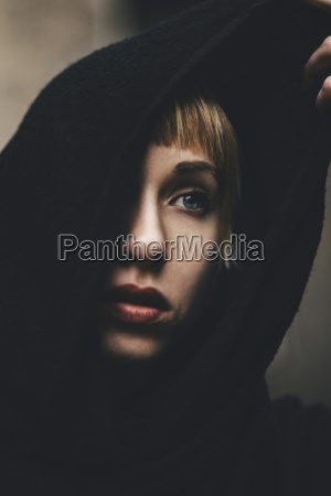 portrait of woman with black hood