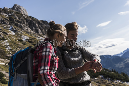 austria tyrol smiling young couple looking