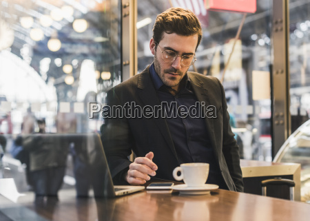 young businessman in a cafe at