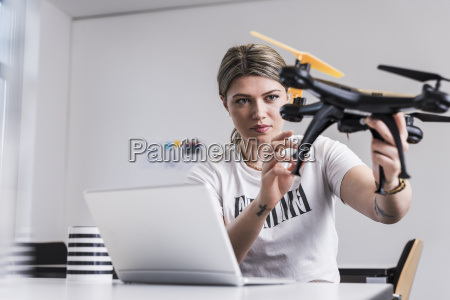 young woman with laptop at desk