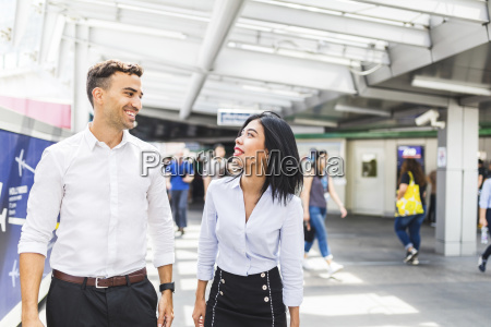thailand bangkok smiling businessman and businesswoman