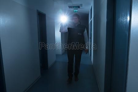security guard holding flashlight