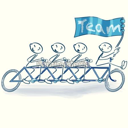 strichmaennchen als fahrradtruppe mit der fahne