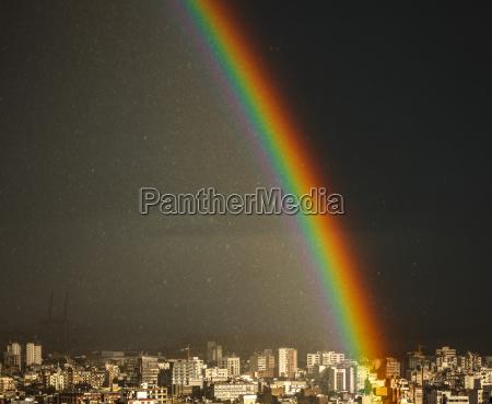 amazing bright rainbow over city