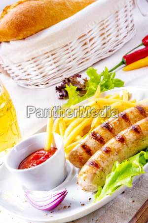 grilled sausage with chips and cold