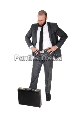 businessman standing thinking looking down