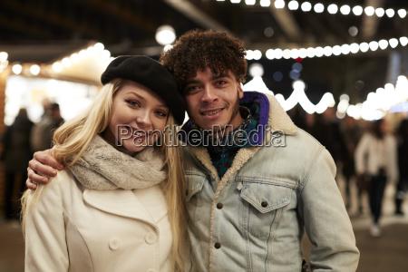 portrait of couple enjoying christmas market