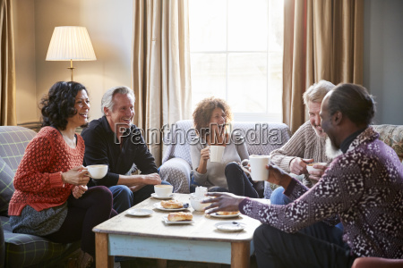 group of middle aged friends meeting