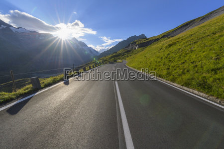 mountain road with sun at grossglockner