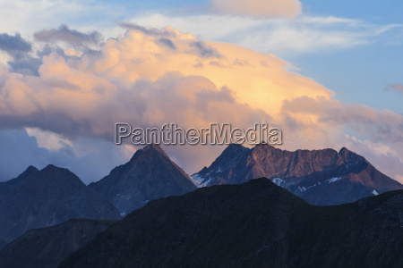 mountains with clouds in the evening
