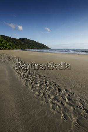 patterns in wet sand on beach