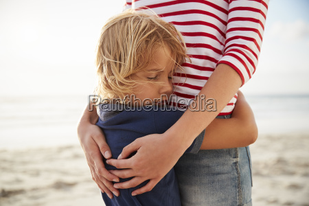 close up of mother hugging son