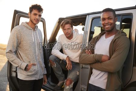 three male friends on road trip