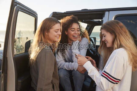 girlfriends planning road trip with tablet