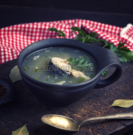 soup with mackerel in a brown