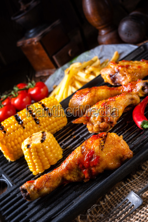 rustic grilled chicken wings legs and