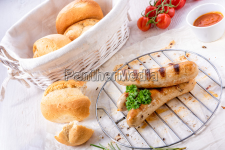 delicious bratwurst with ketchup and fresh