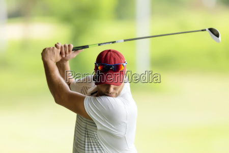 close up of man playing golf