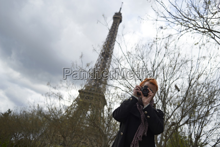 low angle view of photographer using
