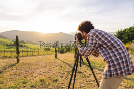 side view of young man photographing