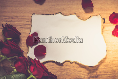 red roses and a blank invitation