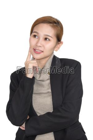 beautiful young asian professional businesswoman thinking