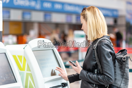 casual caucasian woman using smart phone