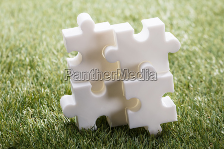 elevated view of four jigsaw puzzle