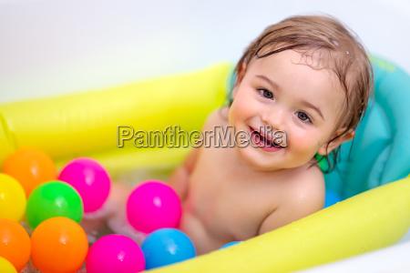 baby boy taking bath