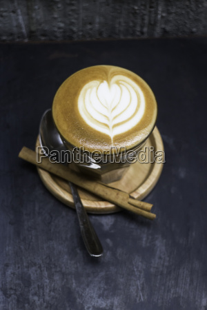 cup of piccolo latte coffee with