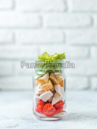 caesar salad in glass mason jar