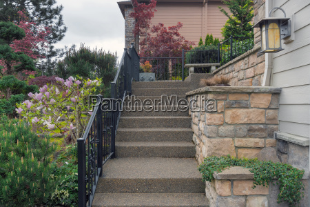 concrete stair steps to house entrance