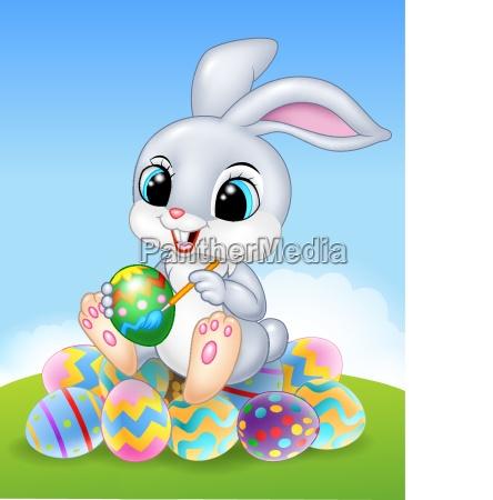 karikatur osterhase der ein ei auf