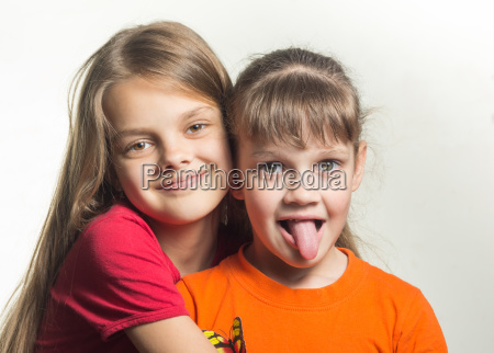 portrait of two sisters having fun