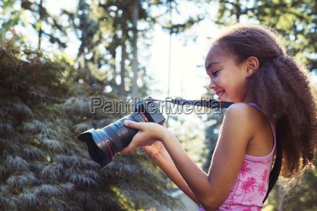 side view of girl using digital