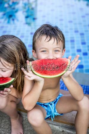 summer vacation children eat watermelon