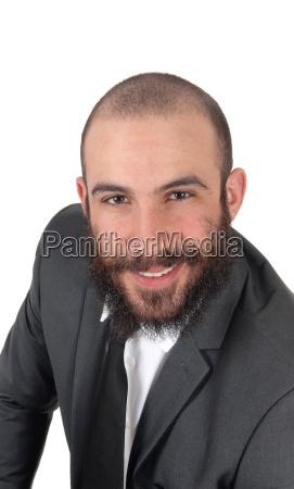 business man sitting bending forward smiling