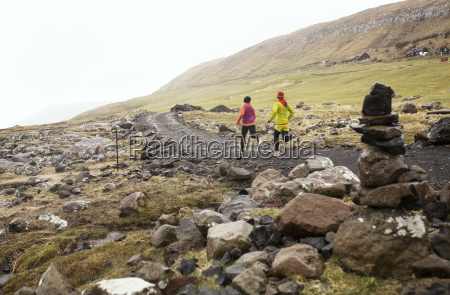 female friends jogging on mountain path