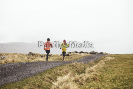 rear view of female friends running