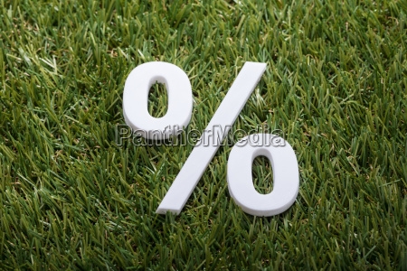 percentage sign on green grass