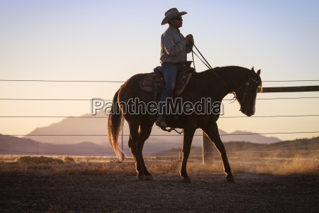 side view of man riding horse