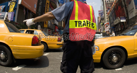 rear view of traffic officer wearing